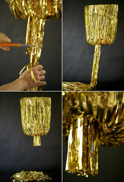 DIY chandelier hanging from vintage jewelry gold garland
