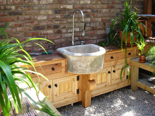 Garden house in the backyard sink drawers wood closet brick wall