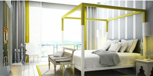 Four-poster beds in the bedroom frame yellow color