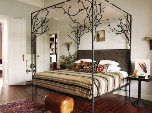 Wooden four-poster beds in the bedroom frame metal mattress