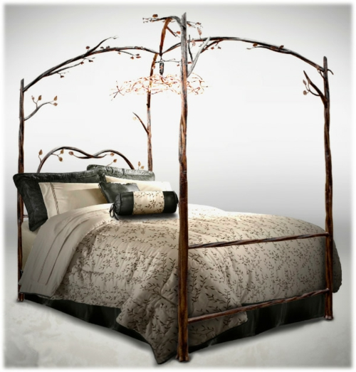 Wooden four-poster beds in the bedroom frame inspired by nature