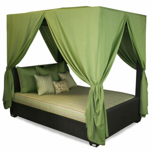 Four-poster beds in the bedroom green curtains