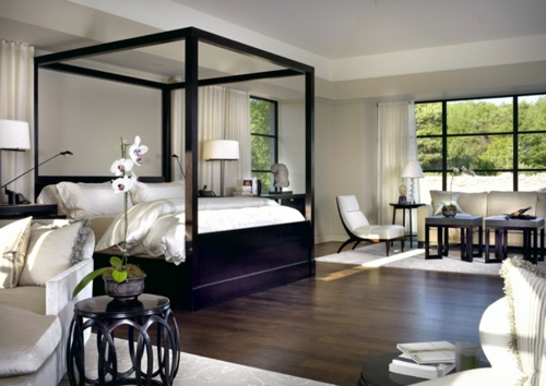 Wooden four-poster beds in the bedroom solid square