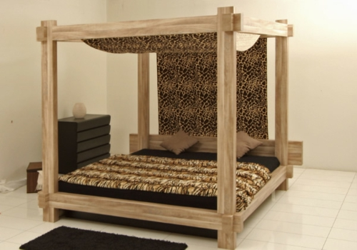 Wooden four-poster beds in the bedroom massive structure