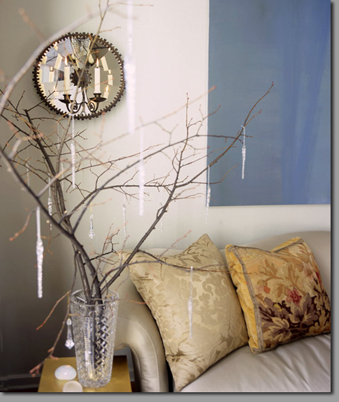 Interior decoration with branches vase couch table sofa pillows