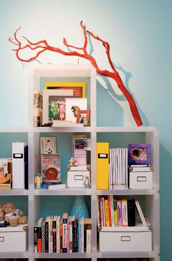 Interior decoration with branches red bookshelves nursery design