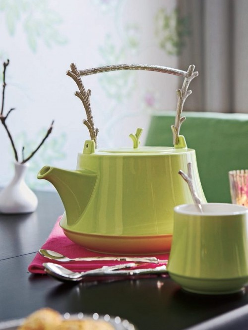 Pitcher interior decoration with branches table green spoon