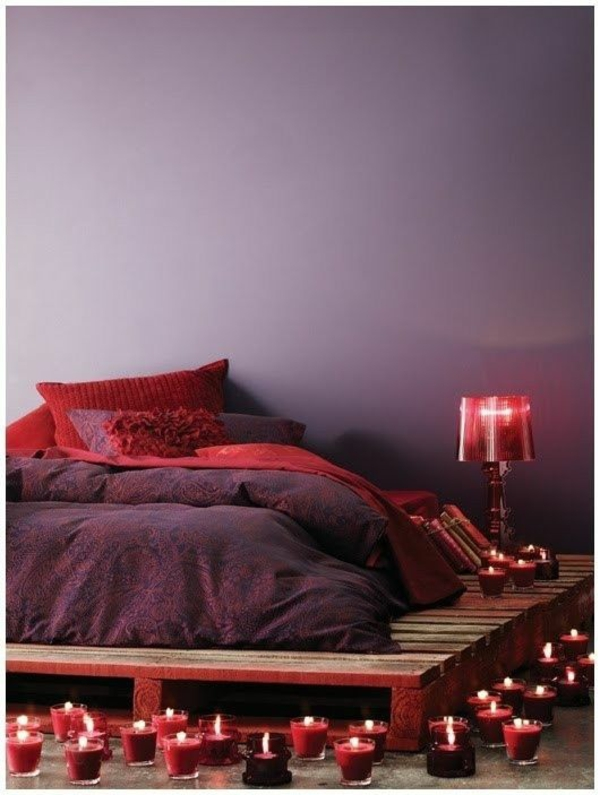 Furniture candles light red glow Euro pallets bed frame romantic