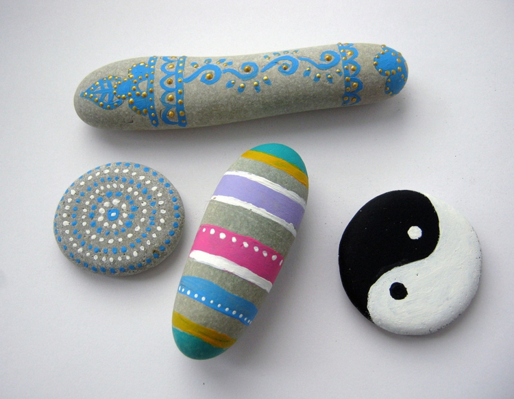 Stones painted colorful stripes Yin and Yang painted stones