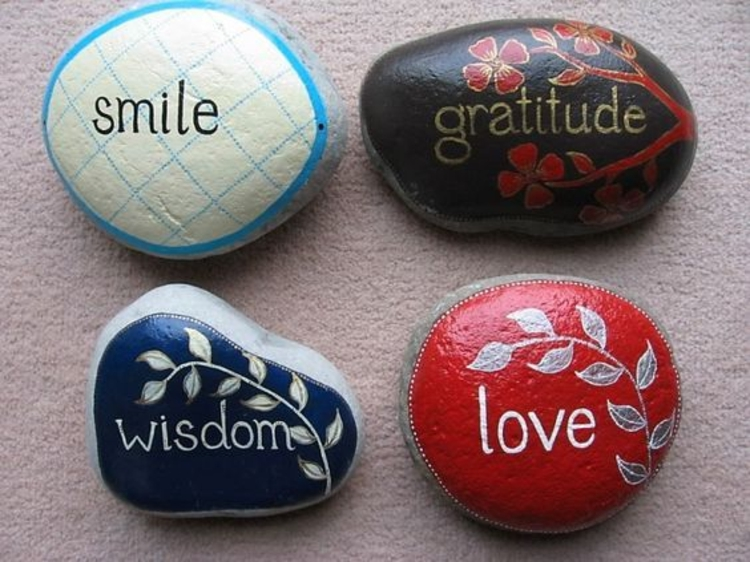 Stones paint positive energy by tinkering with stones