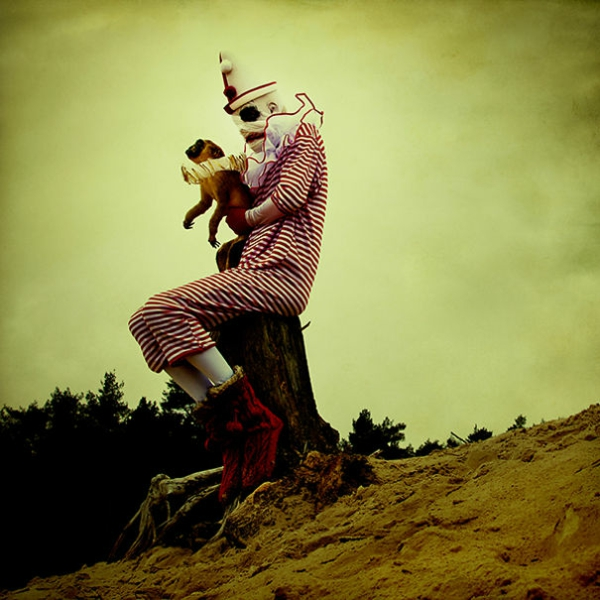 Surrealism pictures and features circus klown