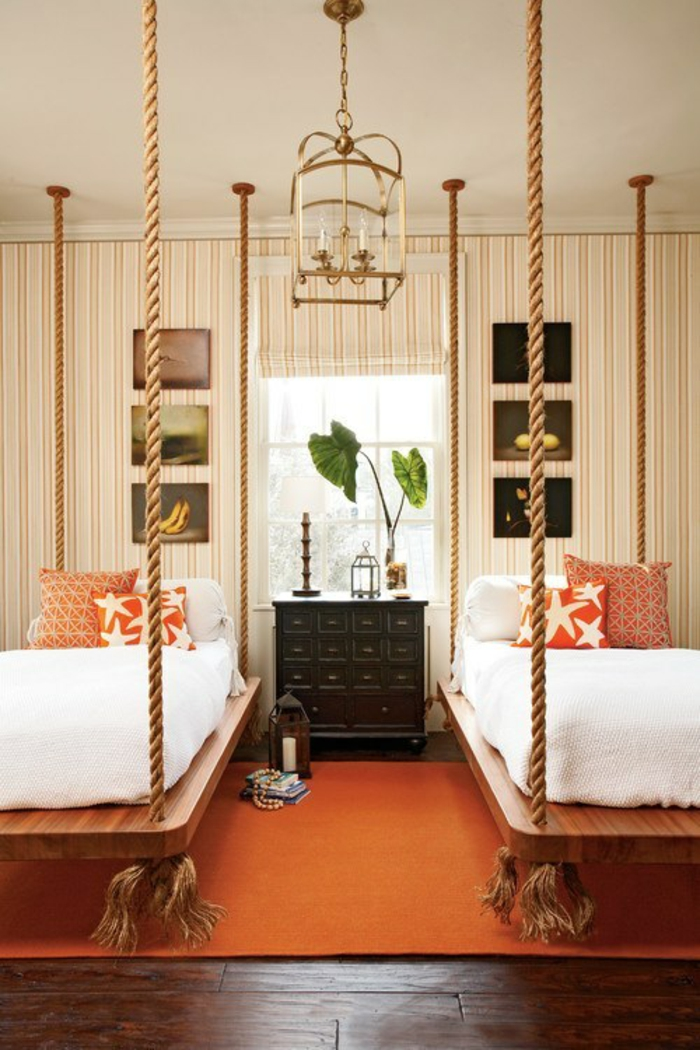 fancy beds hanging ropes wood panels
