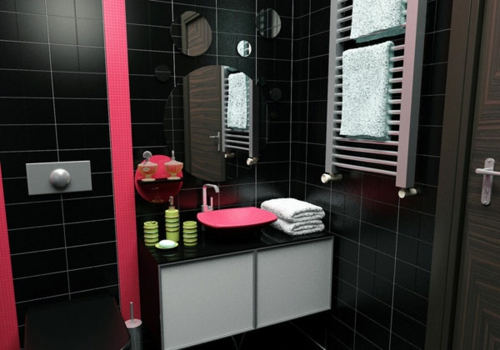 bathroom furnishing black wall tiles pink accents round mirrors