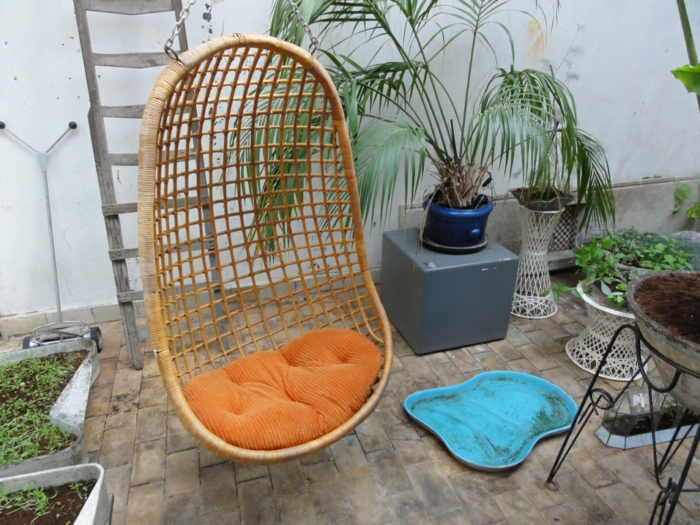 balcony design hanging chair orange seat cushion rattan furniture