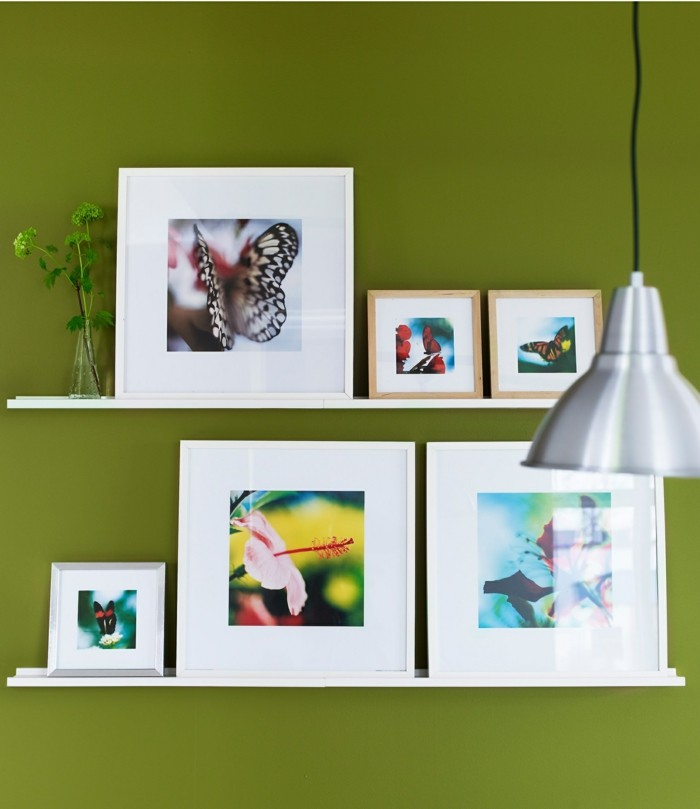 picture frames murals decorating green wall