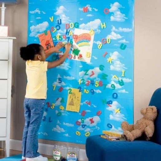blue magnetic board in the nursery blue armchair