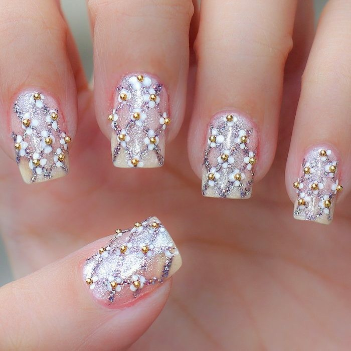 floral designs with nail polish and small gold wedding beads