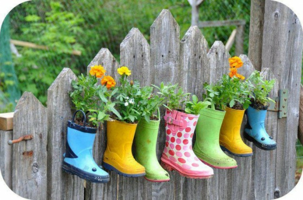 Flower pots of colorful rubber boots