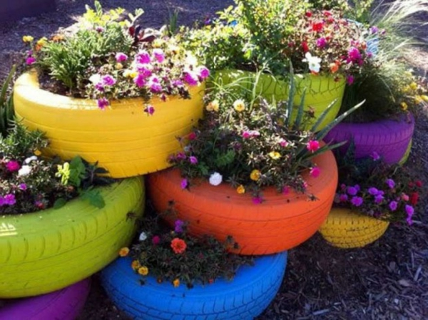 Flower pots of colorful painted car tires