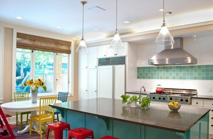 colorful kitchen set up red stools green kitchen island