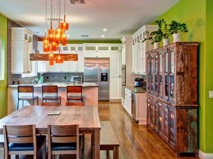 colorful kitchen green wall color orange hanging wooden table
