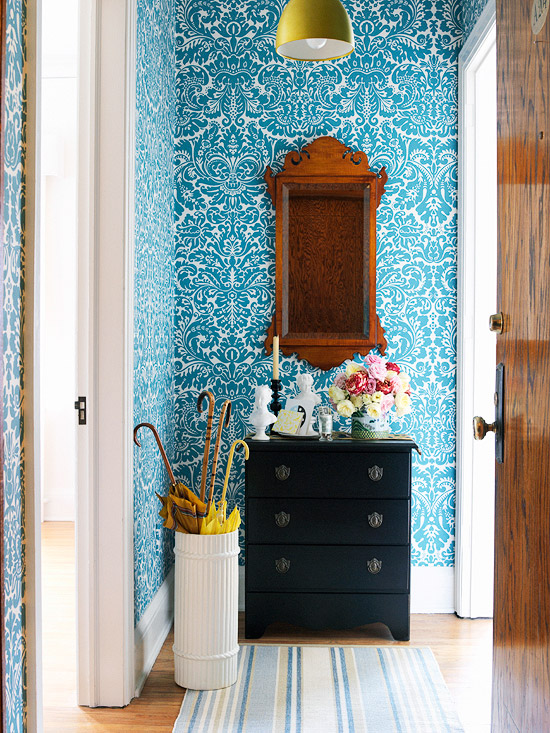 The entrance area perfectly decorated floral patterned wallpaper