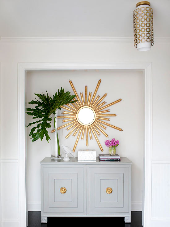 The entrance area perfectly set up stylized sun as a mirror
