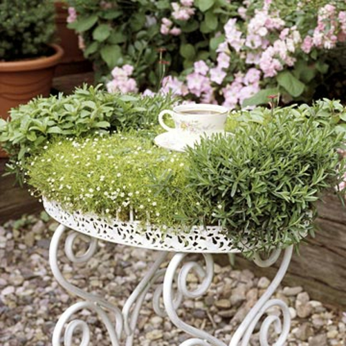 a mini garden shape side table herbal
