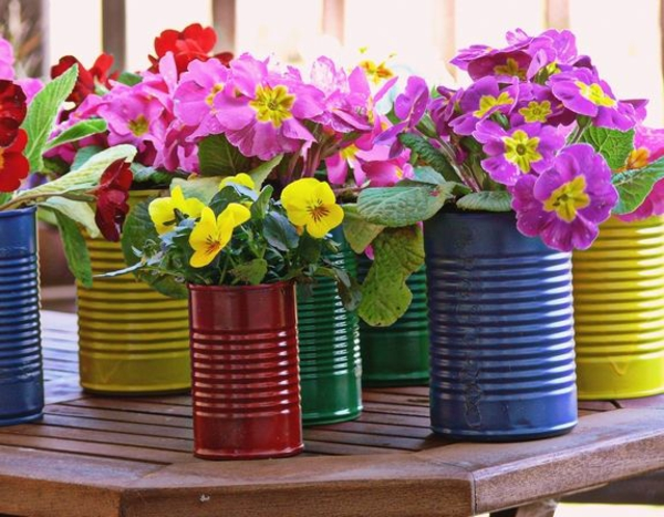 spring decoration tinker with children colored tin can flowerpots
