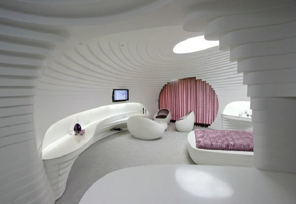 futuristic bedroom designs snail-shaped with pink accents