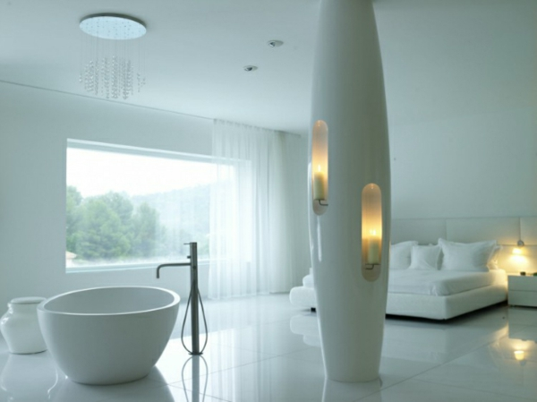 futuristic bedroom freestanding oval tub and built-in candle holders