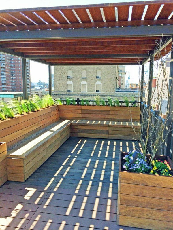 garden pergola made of metal and wood garden furniture wooden bench balcony plants