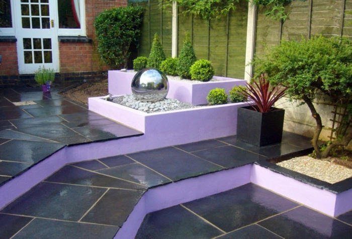 garden ideas garden fountain gradual garden design purple elements
