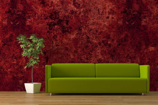 green couch and red wallpaper