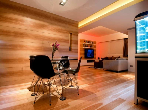 bright wall colors living area wood panel wall wood floor wood finish