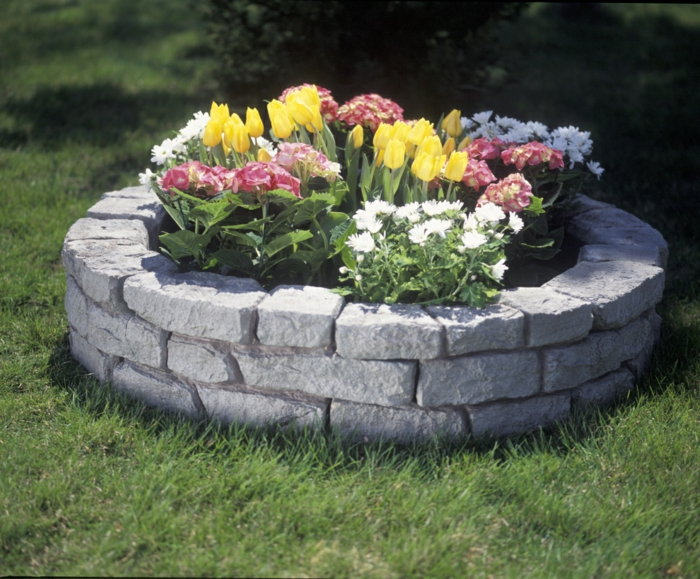 raised bed design stone round stylish flowers