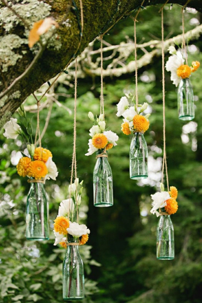 Wedding decor trends flowers hanging glass bottles