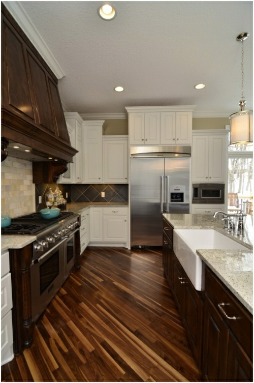 wooden floor in the kitchen walnut wood cabinets