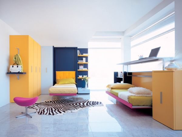 Smart designs with foldaway single bed in pink and yellow
