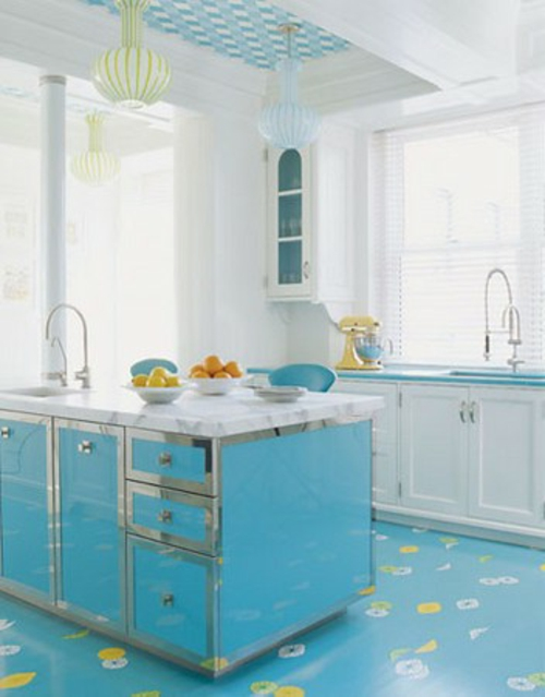 kitchen island in turquoise with shiny metal edges