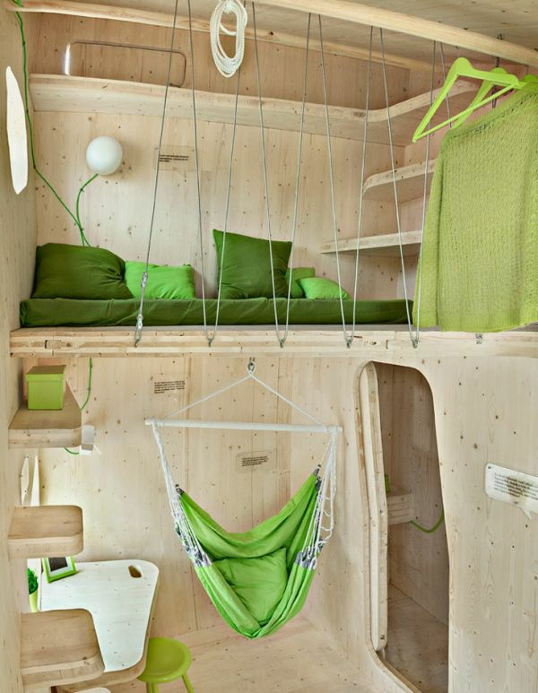 small wooden house student apartment tengbom architekts bedroom high bed living room hanging chair