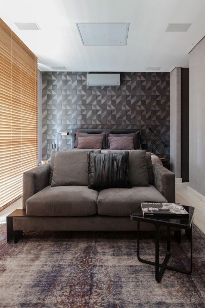 small bedroom set up dark colors brown sofa geometric pattern wall wallpaper wall decoration