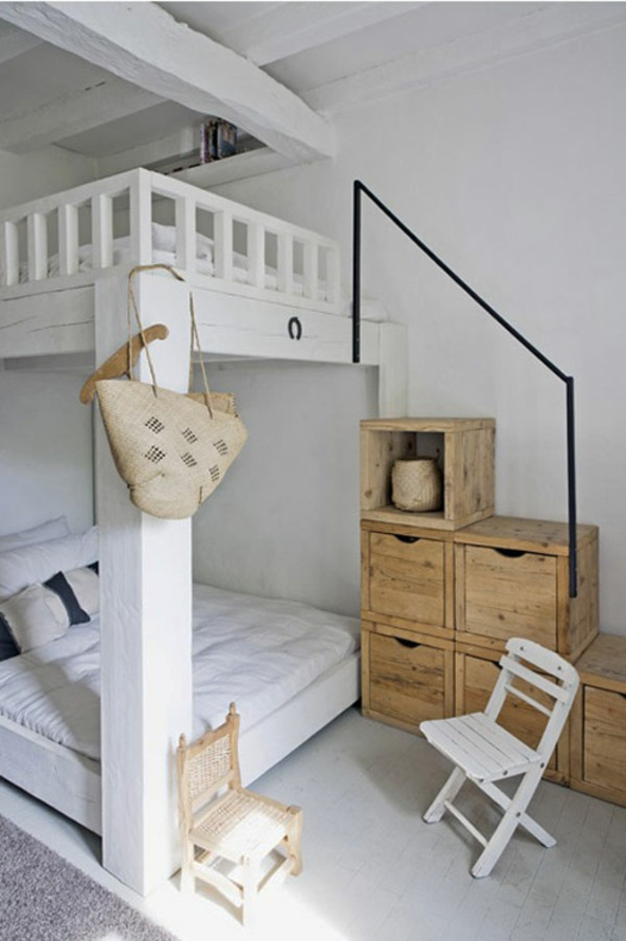 small bedroom furnished bunk bed wooden staircase storage drawers