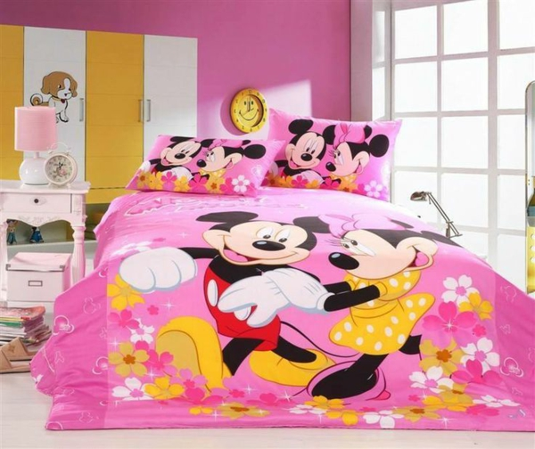 Mickey mouse motifs in the nursery decorating bed coverlet