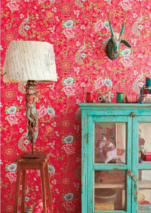 red wallpaper with floral pattern