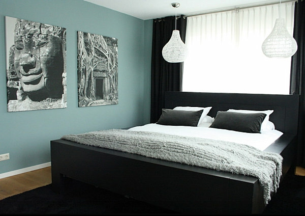 black bedroom furniture contrast wall decoration paintings
