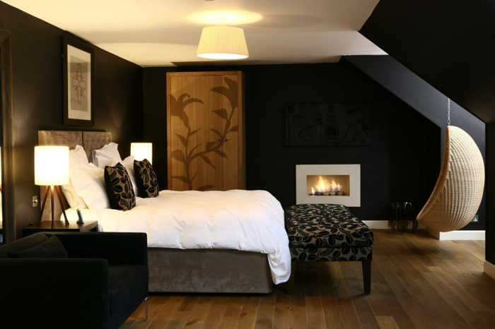black wall paint bedroom fireplace floral accents