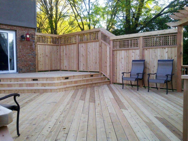 Privacy protection made of wood in the garden design brick wall