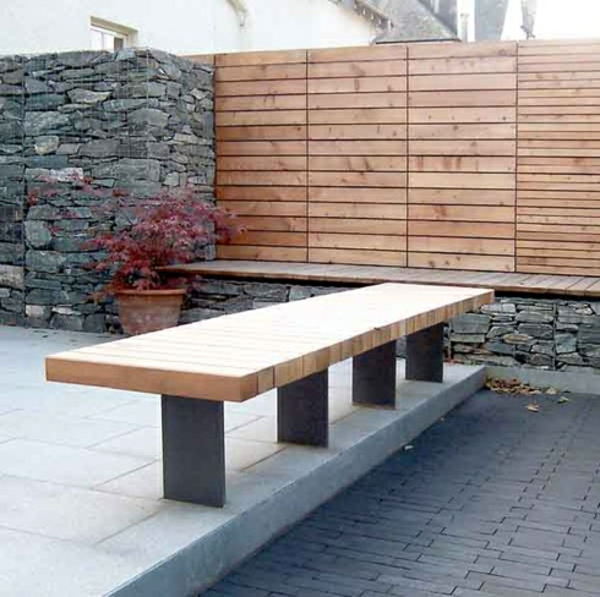 stone wall wood elements garden design bench concrete