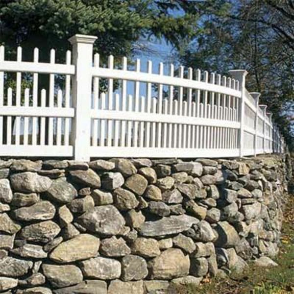 Stone wall with wooden elements garden